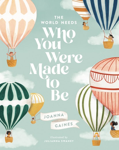 The cover of Joanna Gaines' new children's Who You Were Meant To Be featuring pastel hot air balloons on a light green background.