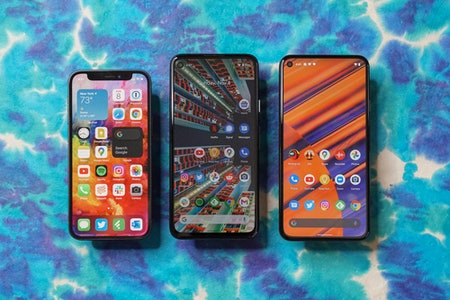 Left to right: iPhone 12 mini, Pixel 4a, and Pixel 5.