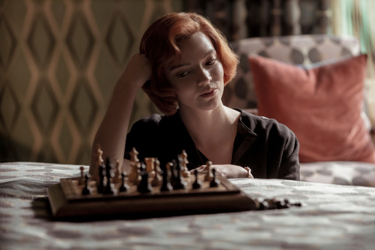 Beth Harmon (Anya Taylor-Joy) sits at a chess board on a bed in 'The Queen's Gambit.'