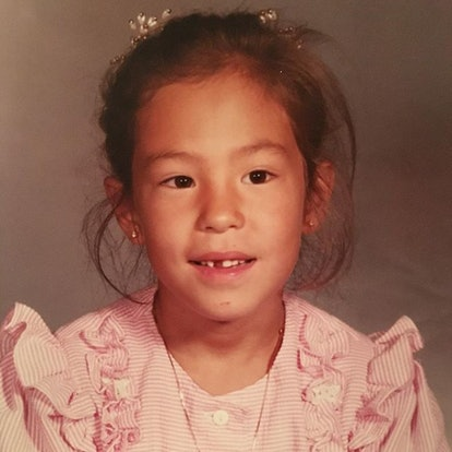 A photo of Joanna Gaines as a little girl, in which she wears a ruffly pink dress.