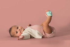 baby girl wearing owlet sock