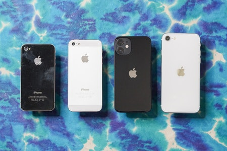 Left to right: iPhone 4, iPhone 5, iPhone 12 mini, iPhone SE (2020).
