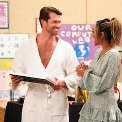 Bachelorette contestant Bennett in a bathrobe talking to Bachelorette Tayshia