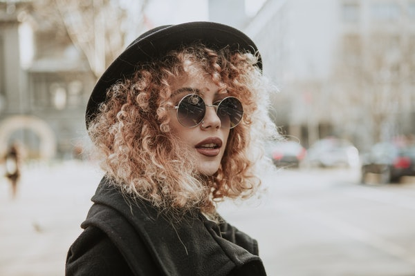 Portrait of a fashionable girl dressed in black
