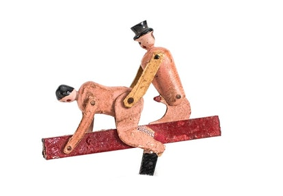 Some figures, like this one carved circa the 1920s, had multiple points of articulation, allowing th...