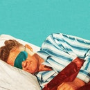 Sleeping man wearing an eye mask.
