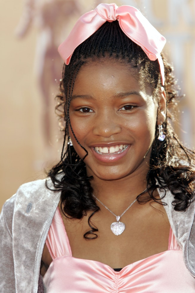 A young Keke Palmer wears a pink bow