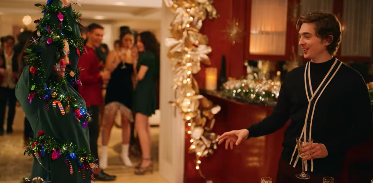 Lily shows off her Christmas tree sweater at a party with Dash in Netflix's 'Dash & Lily.'