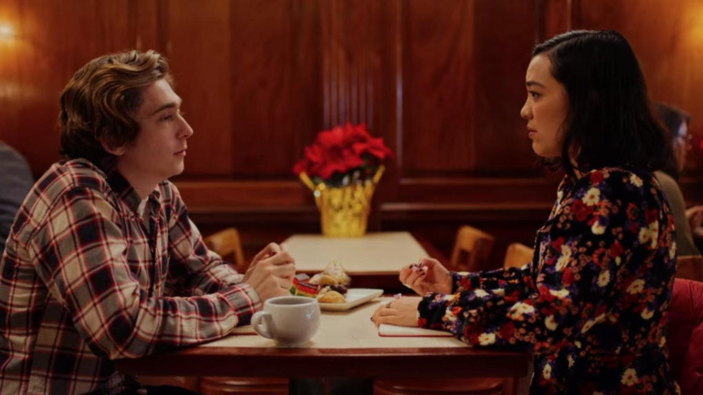 Dash and Lily from Netflix's 'Dash & Lily' sit across the table from each other in a NYC diner.