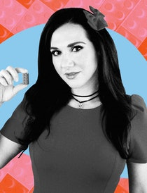A black and white image of Jessica Ewud holding up a single LEGO brick on a blue background with a p...