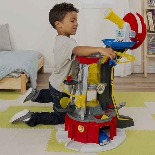 boy playing with paw patrol toy