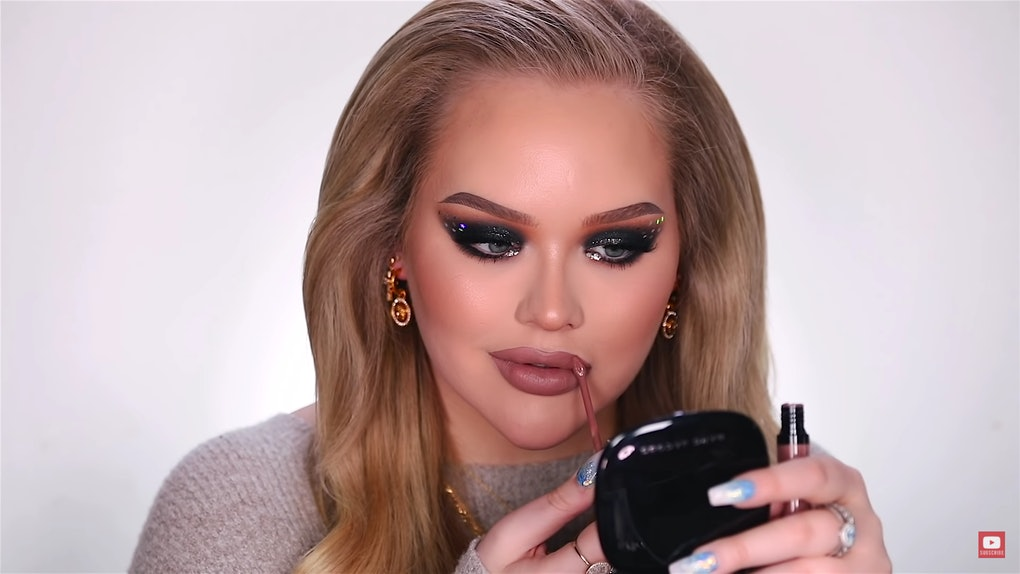 NikkieTutorials applying lipstick to her New Years' Eve makeup look.
