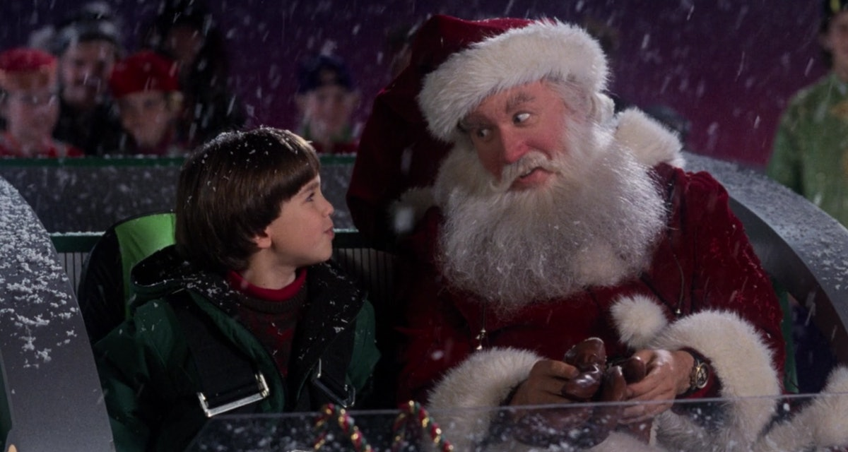 Scott Calvin (Tim Allen) takes on the role of Santa Claus with his son Charlie by his side in the sleigh in 'The Santa Clause.'