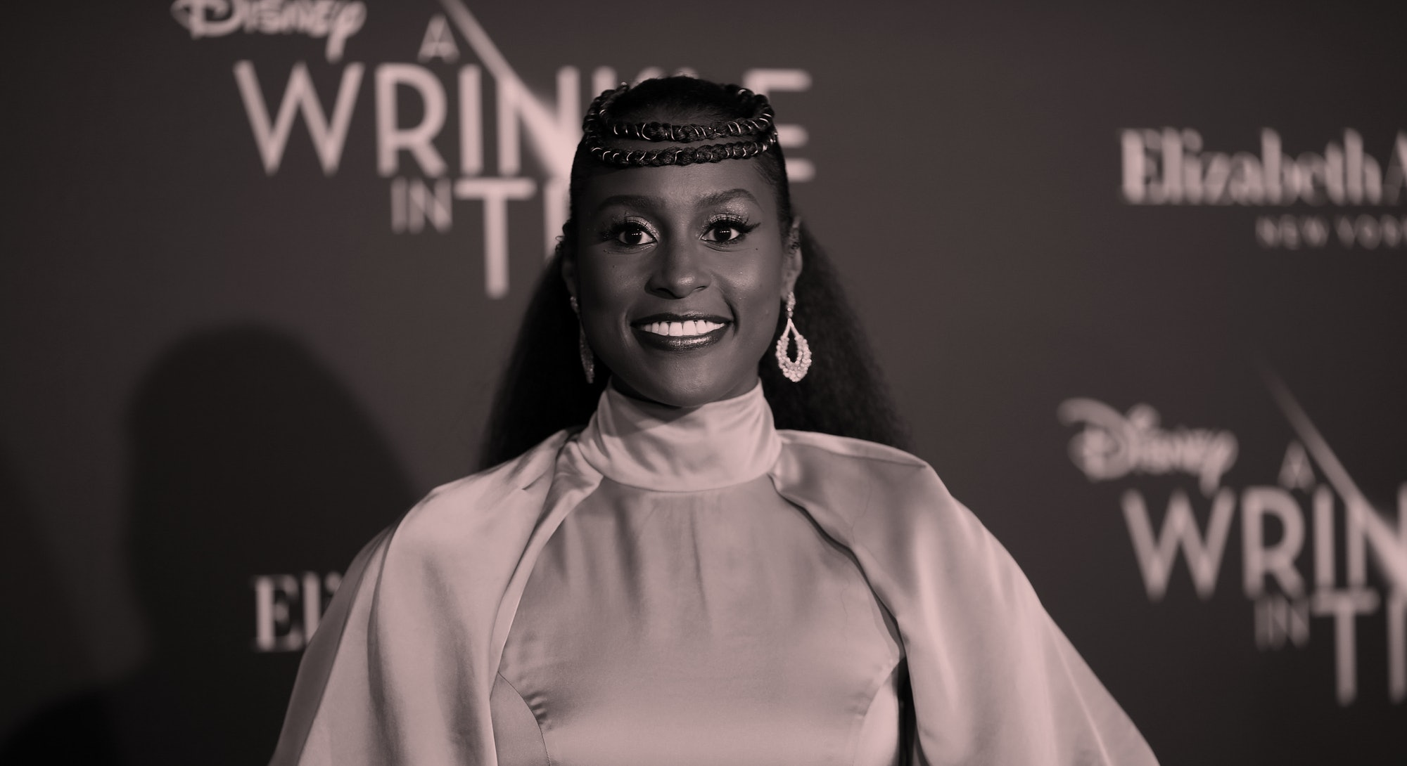Issa Rae wears a yellow dress at the premiere red carpet for A Wrinkle In Time