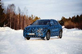 Prototype of the Mercedes-Benz EQA electric SUV in a wintery terrain.