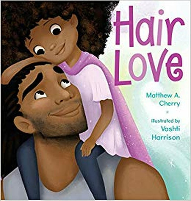 The cover of Hair Love shows an illustration of a Brown girl with big curly hair smiling down at her daddy sho is carrying her.