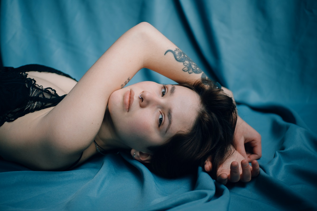 Woman Laying On Blue Cloth