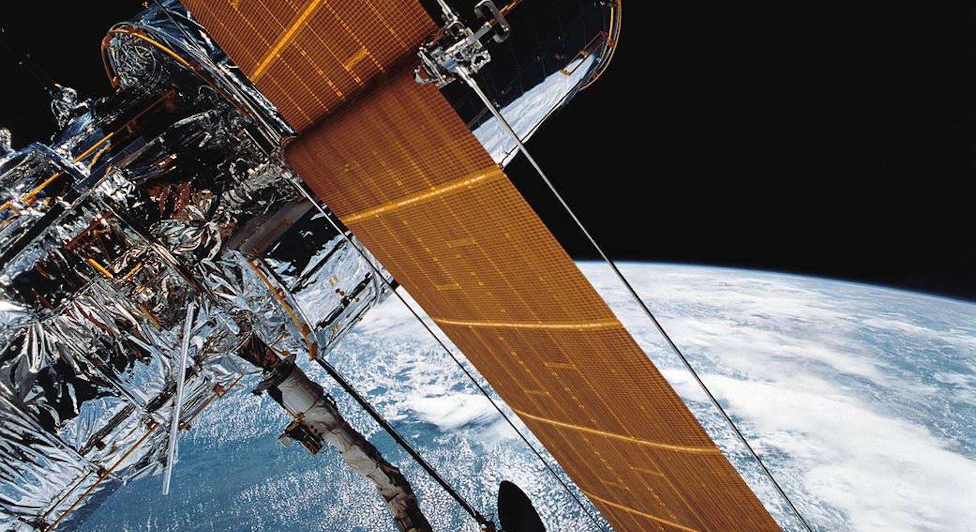 Hubble space telescope above Earth