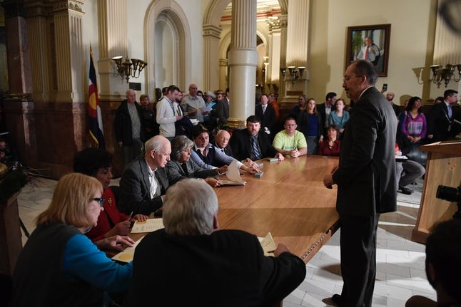 Colorado members of the Electoral College sign their Certificate of Vote, Dec. 19, 2016, in Denver.