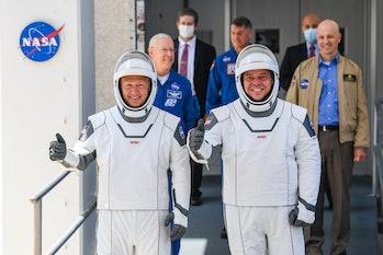 nasa astronauts preparing to board crew dragon