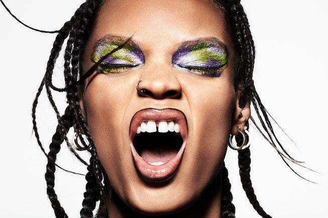 A model, with eyes closed, showcases a colorful makeup look created using MAC Cosmetics's Biobrilliant Glitter Eye Shadow x4
