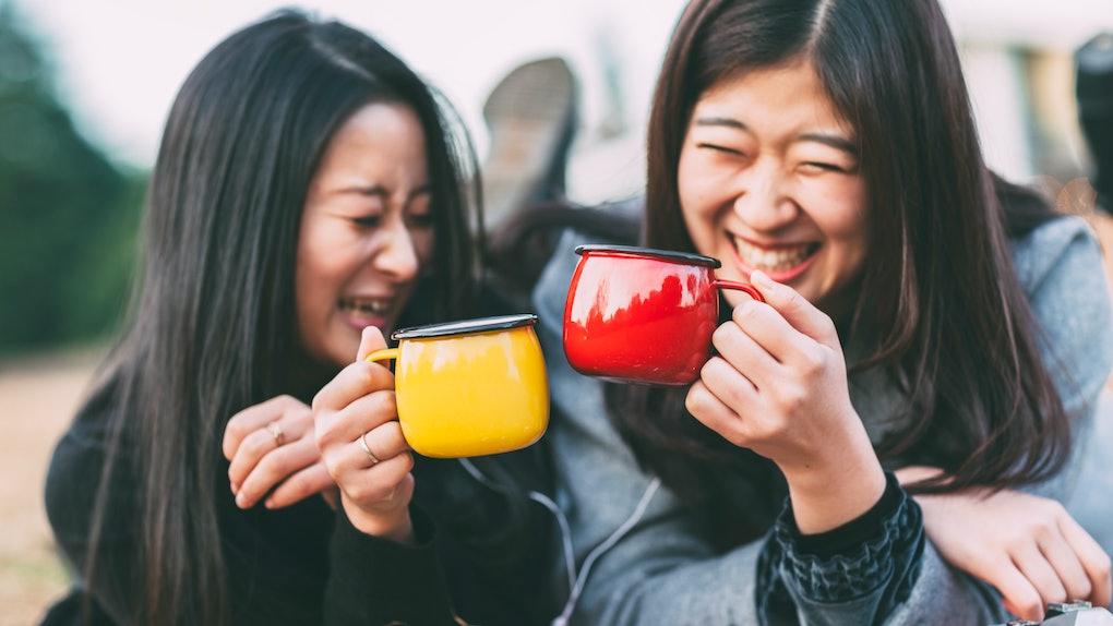 Two Asian women drinking tea