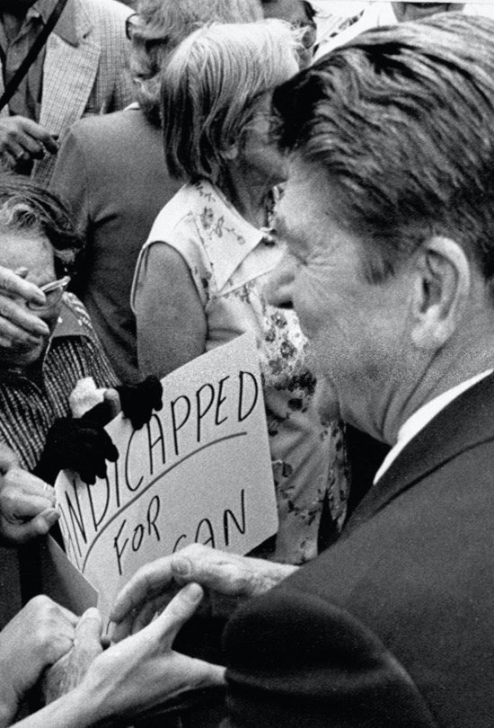 A supporter of Republican presidential hopeful Ronald Reagan puckers up in hopes of getting a kiss from the former governor as he shakes hands with the crowd following a rally.