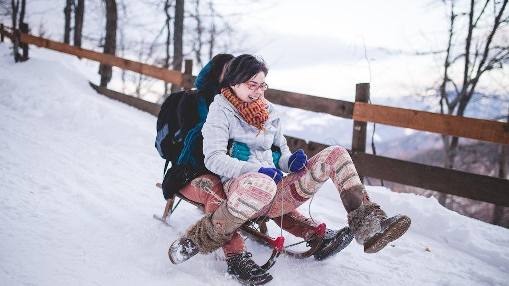 Girls sledding in the snow