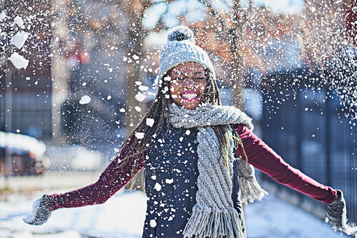 Woman playing in snow