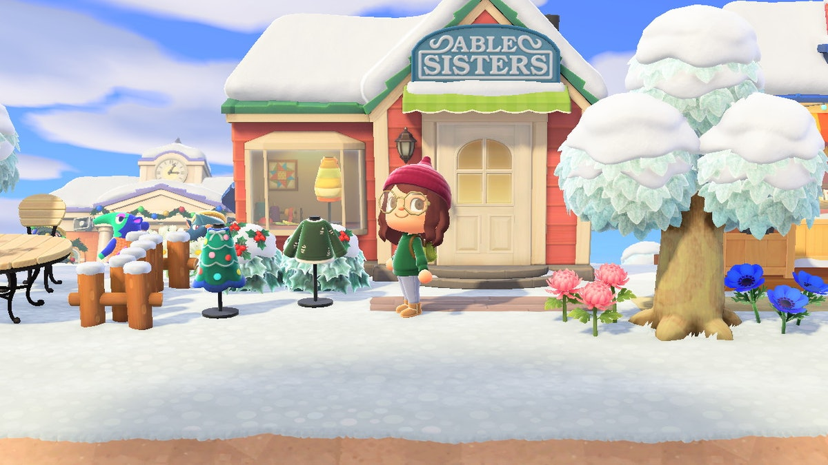 A girl character poses in front of Able Sisters in 'Animal Crossing: New Horizons'.