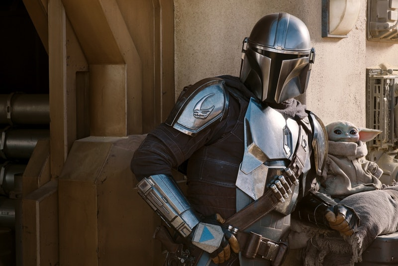 Mando and Grogu in 'The Mandalorian,' via Disney+ press site.