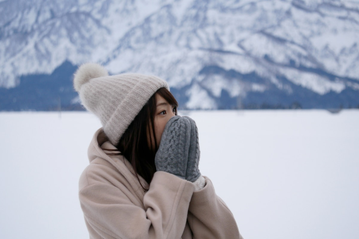 Young woman wearing mittens