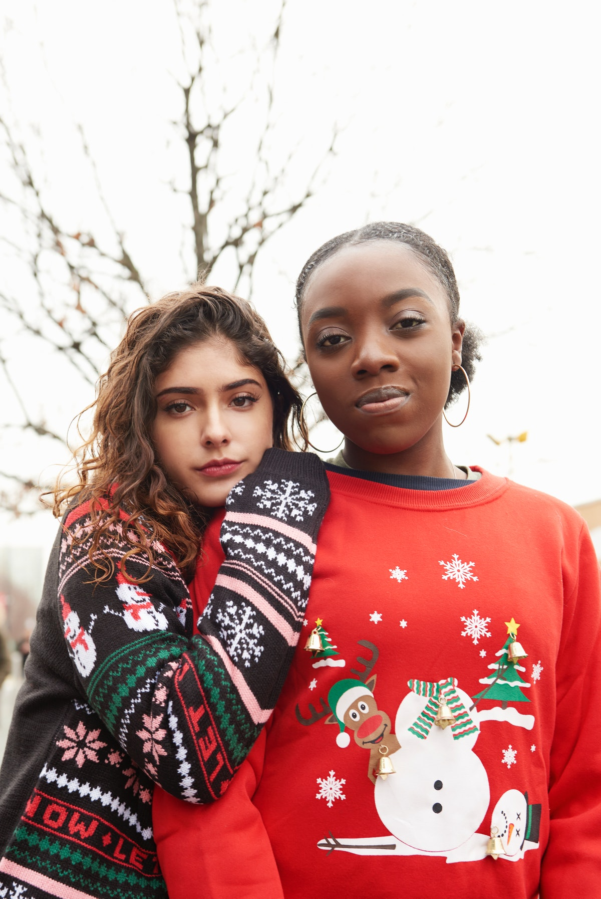 Friends posing in Christmas sweaters