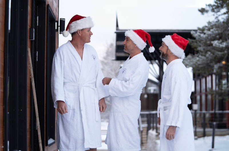 Gordon Gino and Fred walk through the snow in  dressing gowns as he heads for a sauna