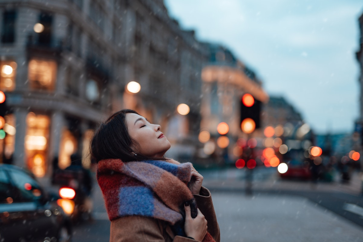 Young Woman With Scarf On The City Street