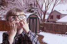 Boy with broken glasses
