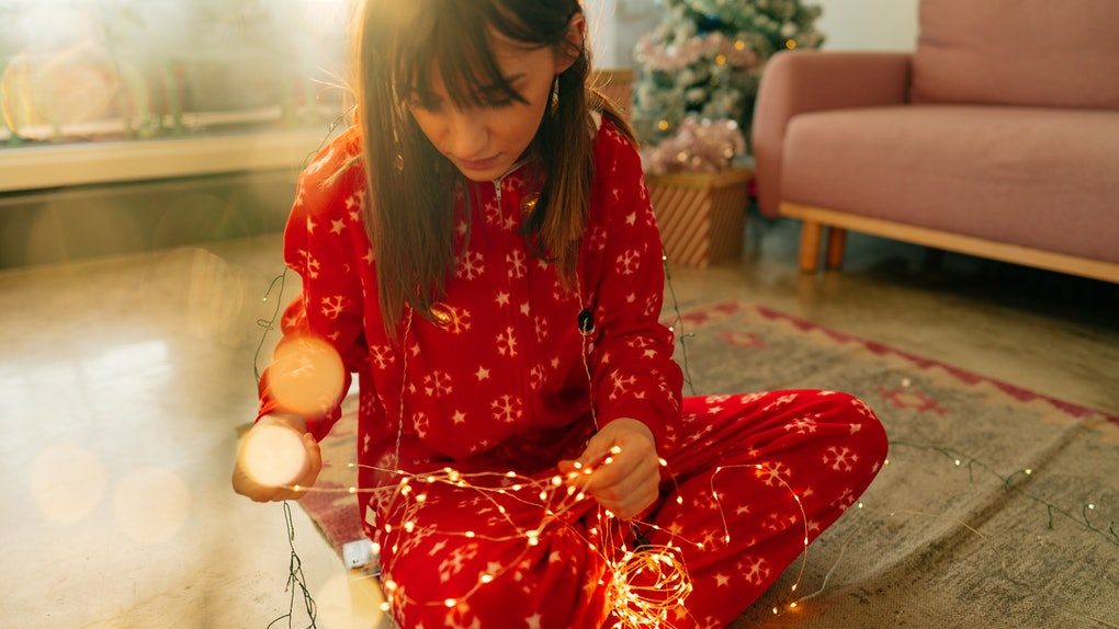 Young woman in Christmas onesie