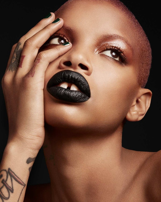 Slick Woods wears dark black Fenty Beauty lipstick