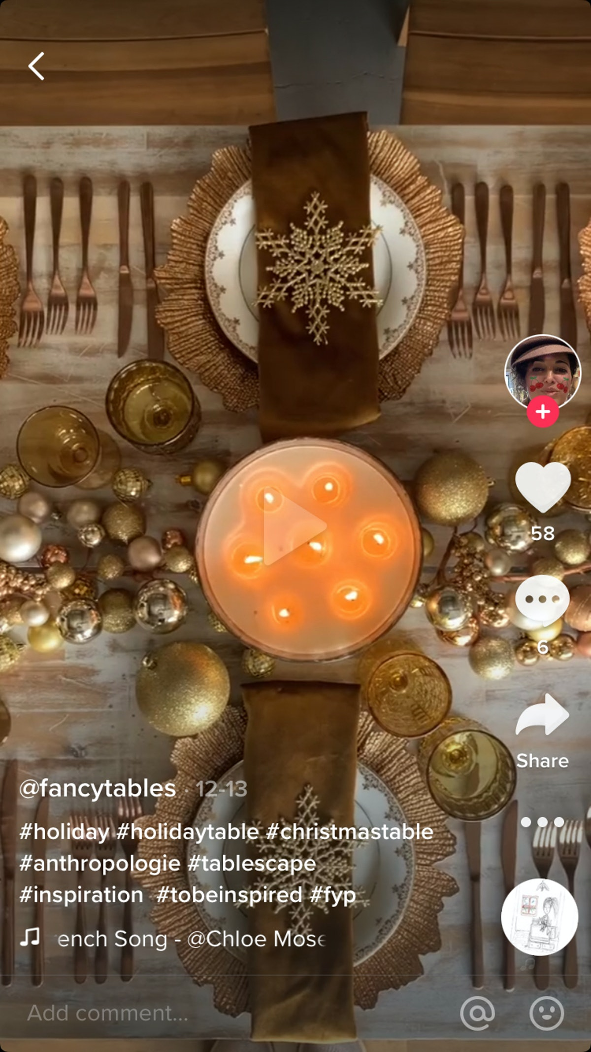 A TikTok user decorates a Christmas dinner table with gold charger plates, snowflake napkin rings, and golden garlands.