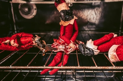 Three Elf on the Shelf elves charred in an oven.