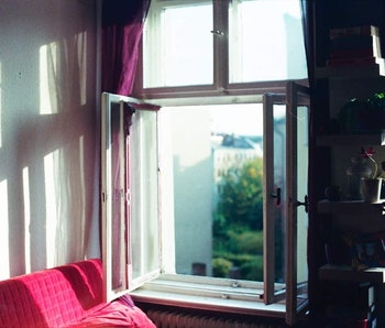 Open window in a room at home