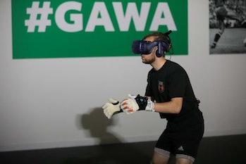 a goalkeeper wears a vr headset