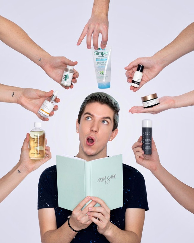 Hyram poses with hands holding skincare products