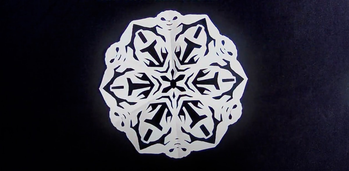 Travis Clark of Whitebread Studios on YouTube shows how to make a Baby Yoda paper snowflake inspired by 'The Mandalorian' on Disney+.