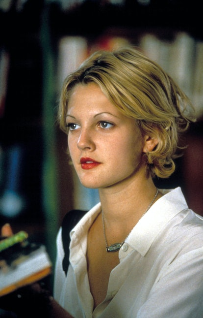 Drew Barrymore with short blonde hair in the '90s.