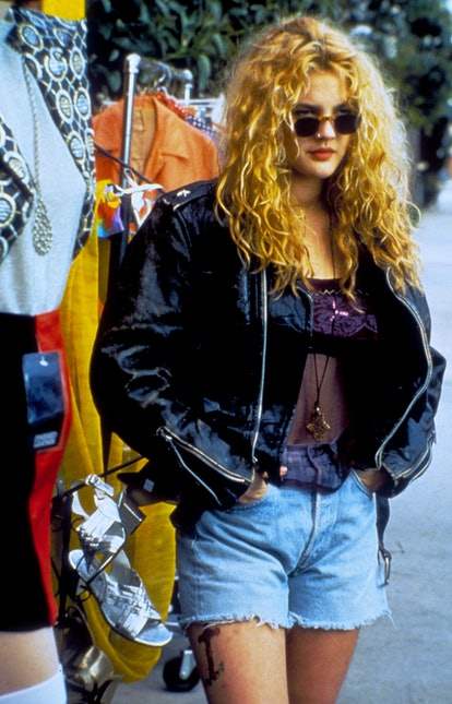 Drew Barrymore with long blonde hair in the '90s.