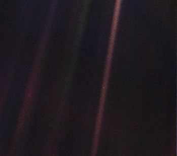 Pale Blue Dot is a photograph of Earth taken Feb. 14, 1990, by NASA's Voyager 1 at a distance of 3.7 billion miles (6 billion kilometers) from the Sun.
