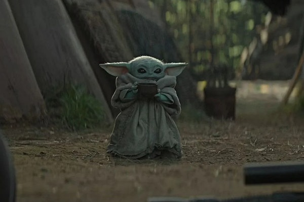 Baby Yoda drinks soup from a bowl in 'The Mandalorian'.