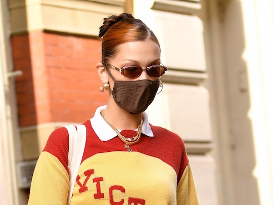 Bella Hadid's yellow sweater is from her favorite menswear brand, Bode