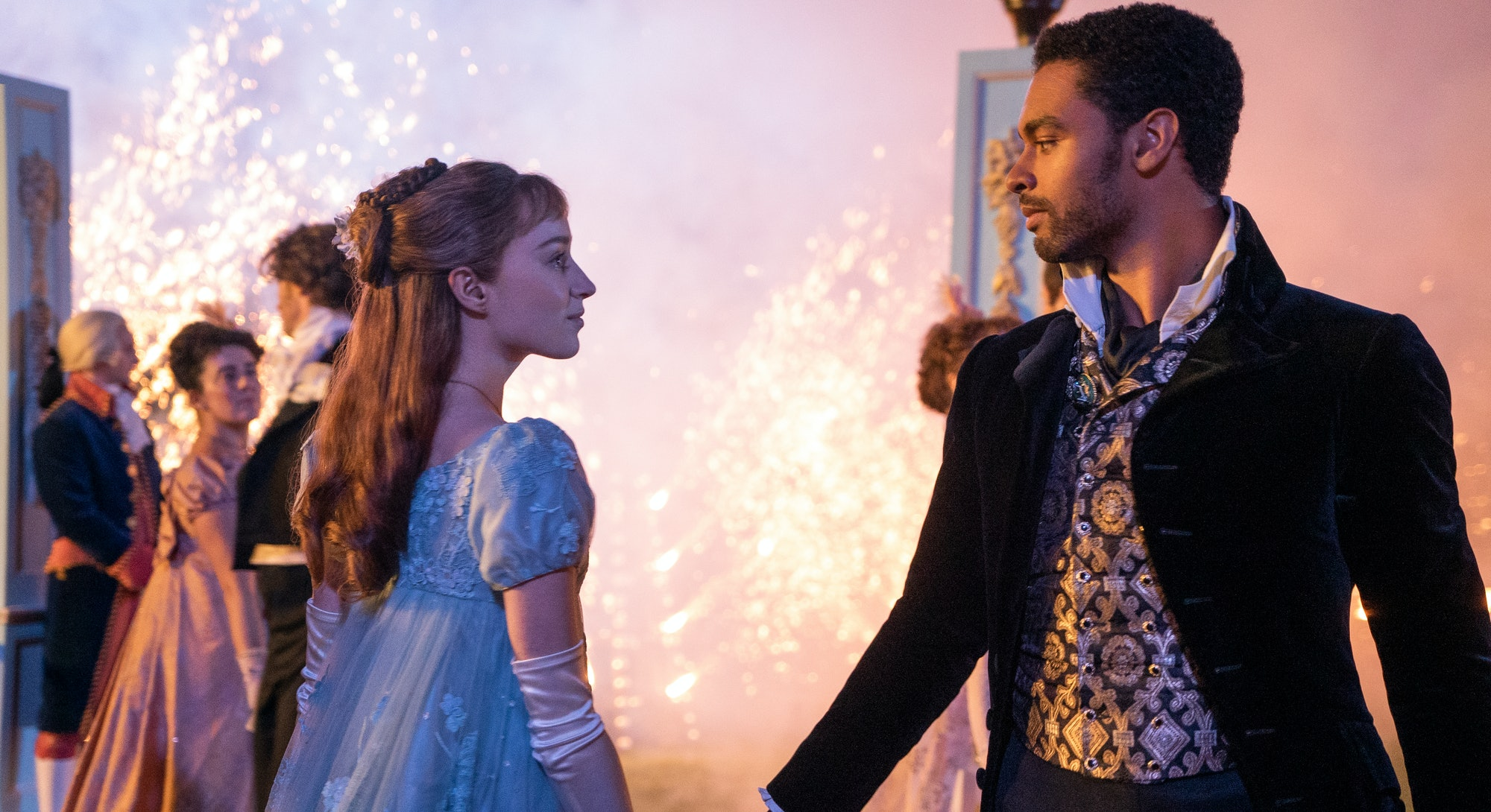 A still from Netflix Bridgerton featuring Daphne and Simon holding hands